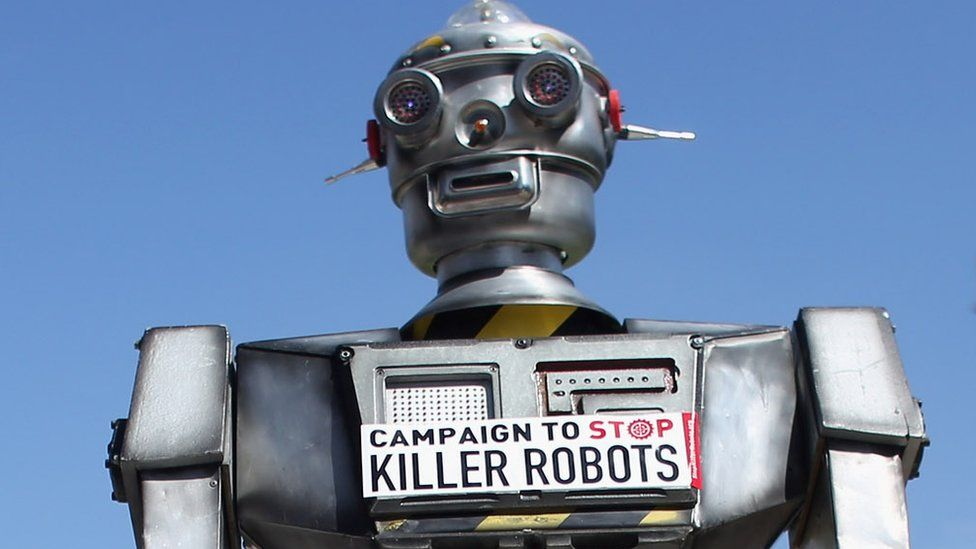 A robot distributes promotional literature calling for a ban on fully autonomous weapons in Parliament Square, London, 23 April 2013