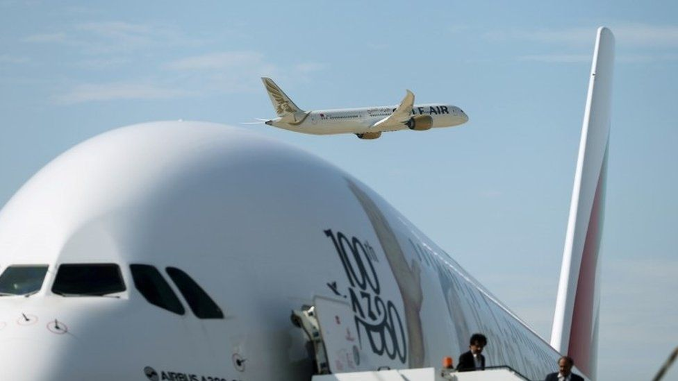 Boeing Dreamliner takes off as A380-800 plane taxis (file picture)