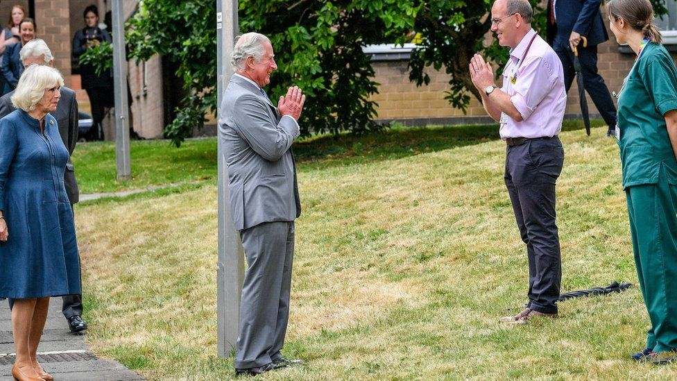 """Prince Charles greeted NHS workers with a socially-distanced """"namaste"""""""
