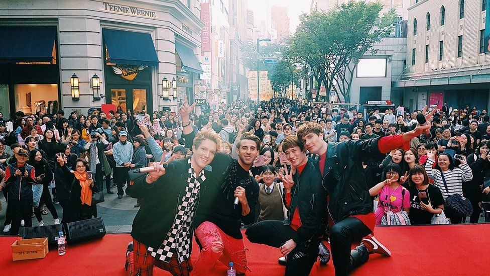The boys performing in downtown Seoul