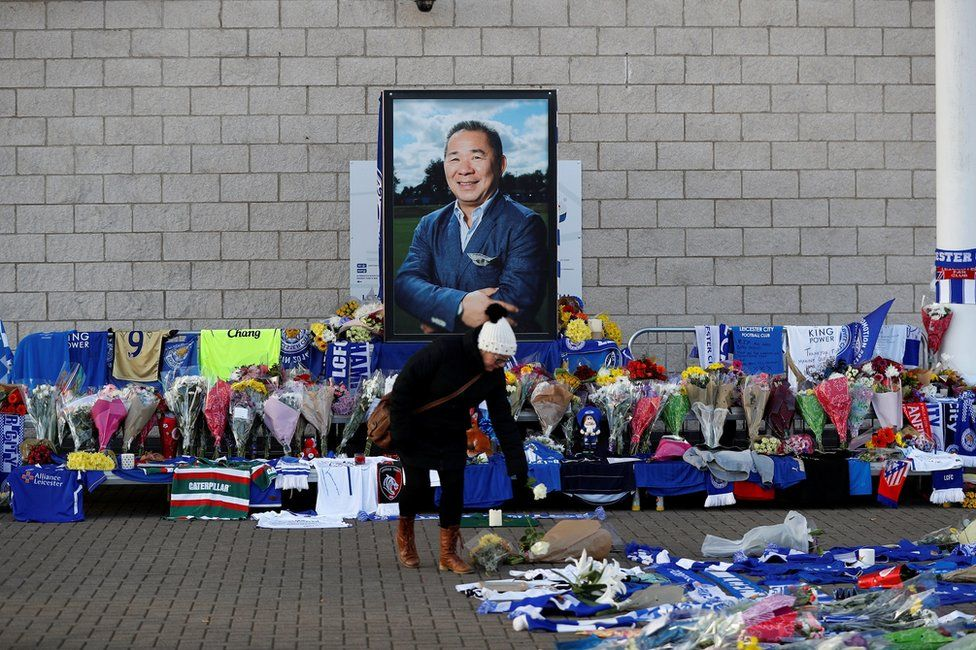 A woman places flowers outside Leicester City's King Power stadium, after the club's owner Thai businessman Vichai Srivaddhanaprabha and four other people died when the helicopter they were travelling in crashed as it left the ground after the match on Saturday, in Leicester, Britain, October 29, 2018