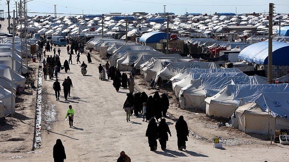 Women walk at al-Hol displacement camp in Hasaka governorate, Syria April 1, 2019.