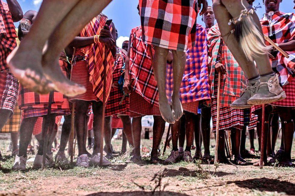 Men from the Kenyan Maasai tribe jump in unison during the rites.