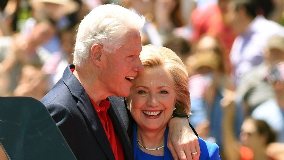 Former Secretary of State Hillary Clinton and Former US President Bill Clinton hug after she officially launched her campaign for the Democratic presidential nomination in 2015