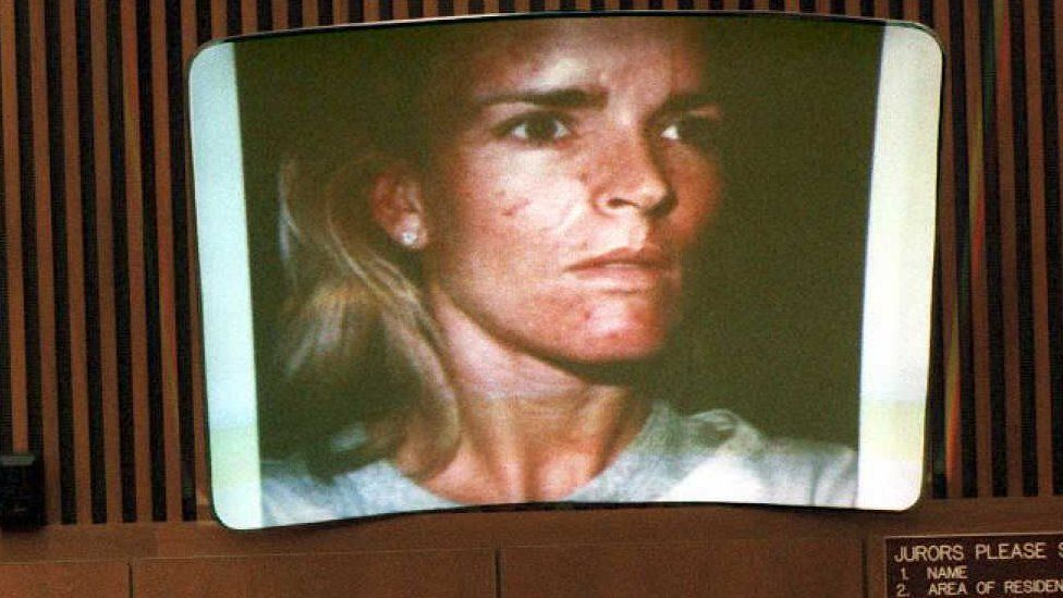 A picture of a beaten Nicole Brown Simpson taken on 01 January 1989 is displayed in court