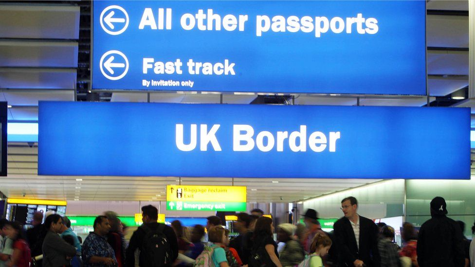 Border control signs at heathrow airport