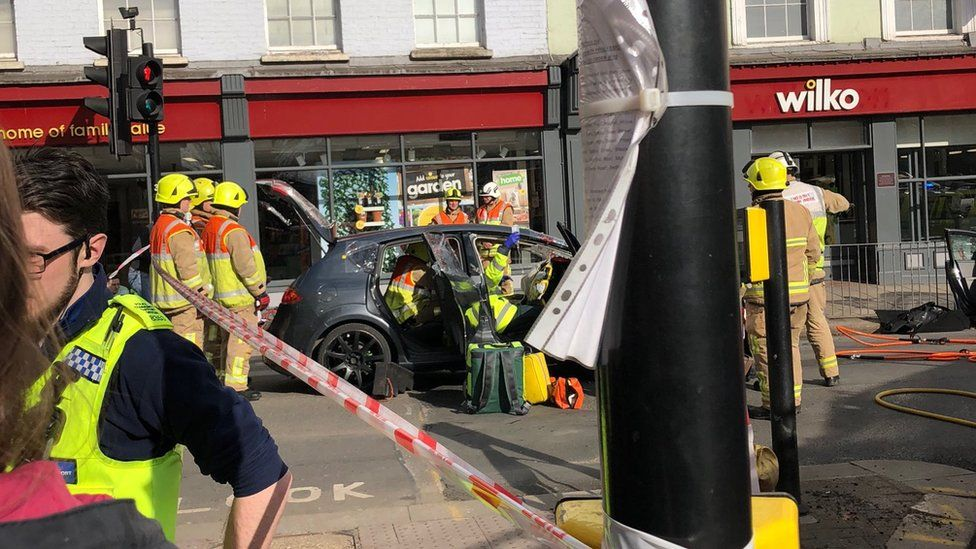 Firefighters at the scene of a car incident