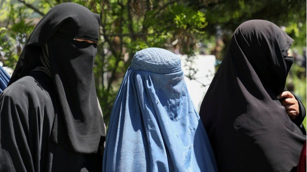 Afghan women wait in line for wheat, April 2021