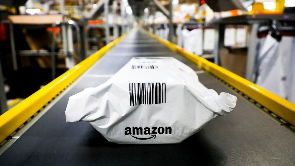 A product sits on a conveyer belt in an Amazon warehouse