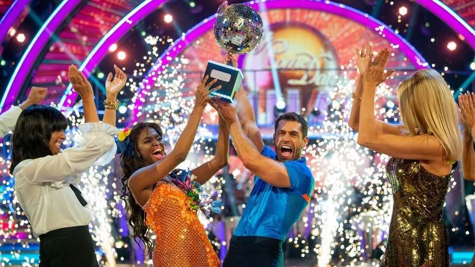 Oti Mabuse and Kelvin Fletcher lift the trophy
