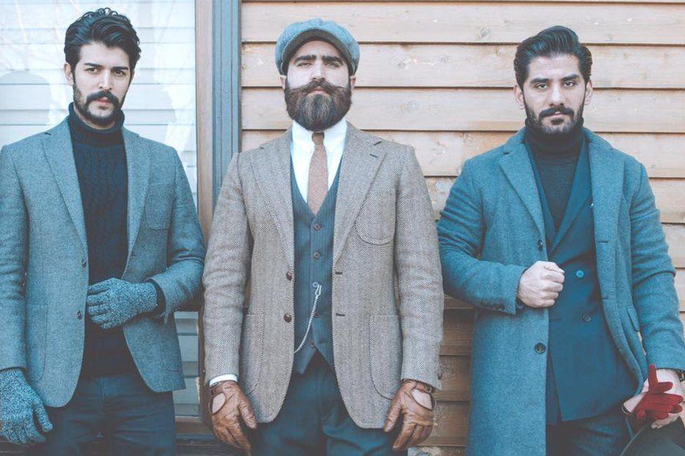 Iraqi men posing in suits