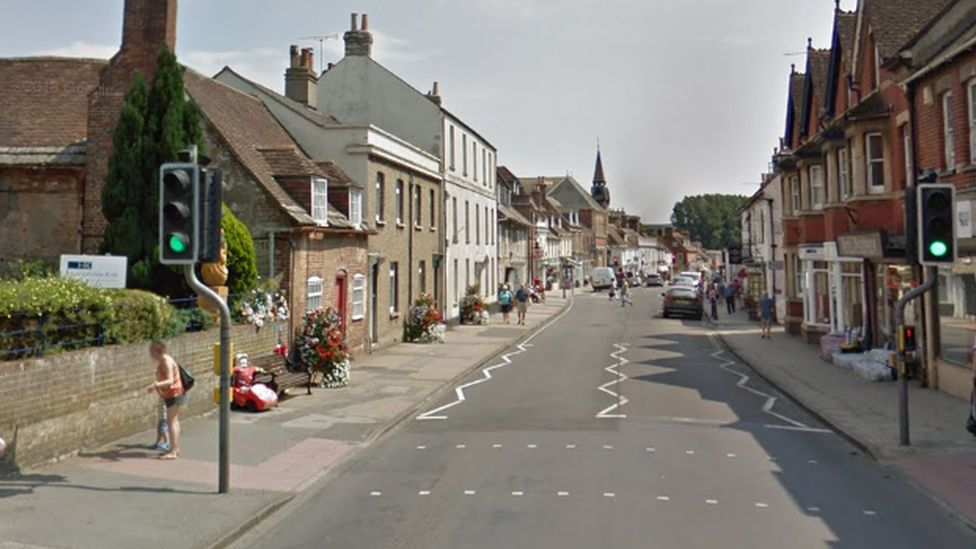 Crash location at North Street, Wareham - showing tributes to Jaiden on a bench on the left