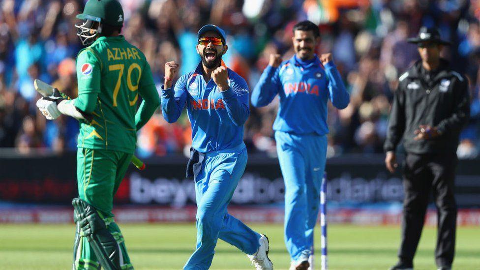Virat Kohli (2L) of India celebrates as Ravindra Jadeja captures the wicket of Azhar Ali of Pakistan during the ICC Champions Trophy match between India and Pakistan at Edgbaston on June 4, 2017.