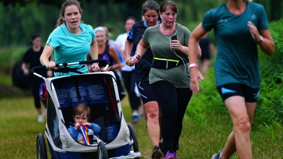 Runners taking part in the Parkrun at Bushy Park in London, the largest and oldest Parkrun in the UK