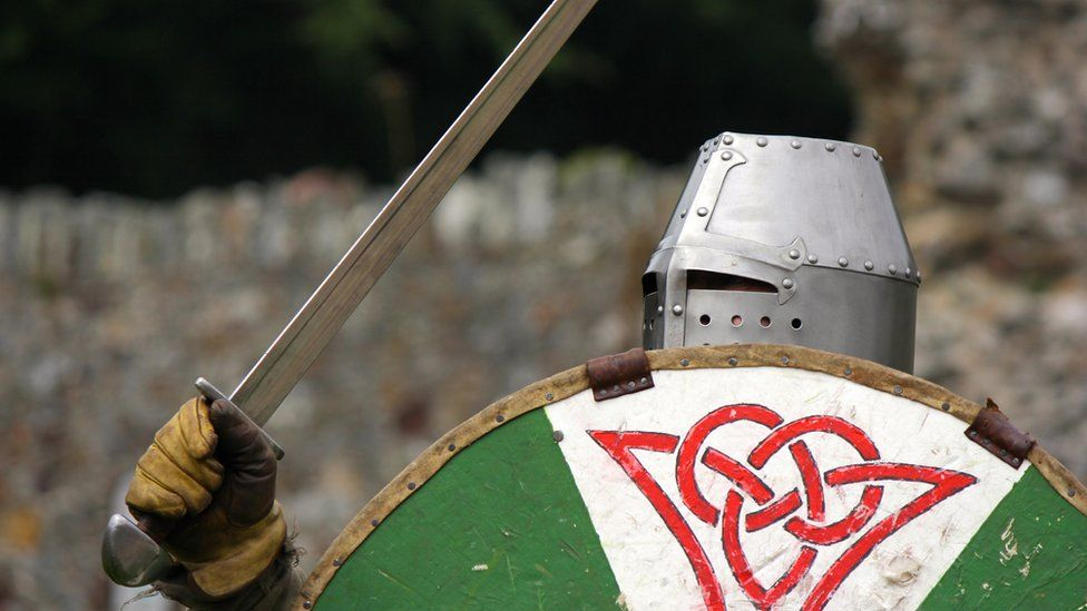 Historical re-enactor with sword and shield