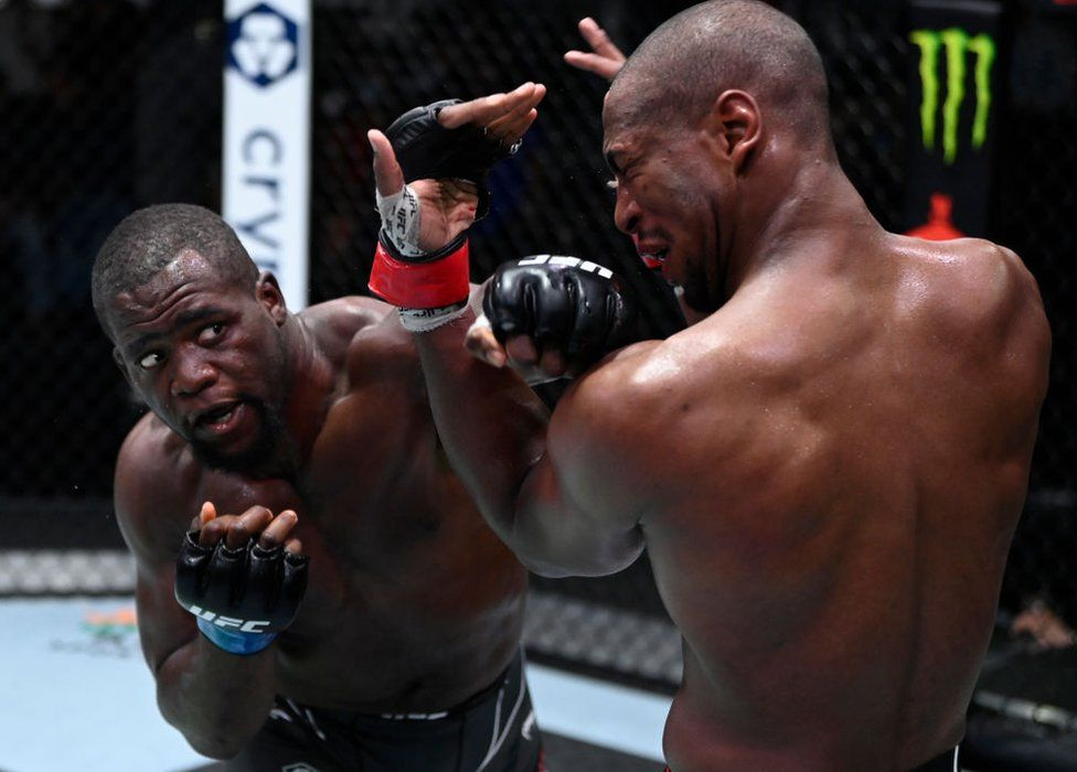 Tafon Nchukwi of Cameroon punches Mike Rodriguez in a light heavyweight fight during the UFC Fight Night event at UFC APEX on September 18, 2021 in Las Vegas, Nevada.