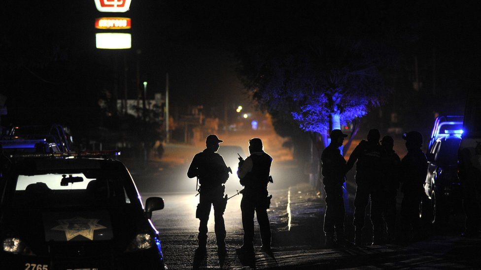 Members of the Mexican Army and Federal police patrol a crime scene after an organized crime shooting at the Villa Juarez neighbourhood in Navolato, State of Sinaloa on 7 February, 2017