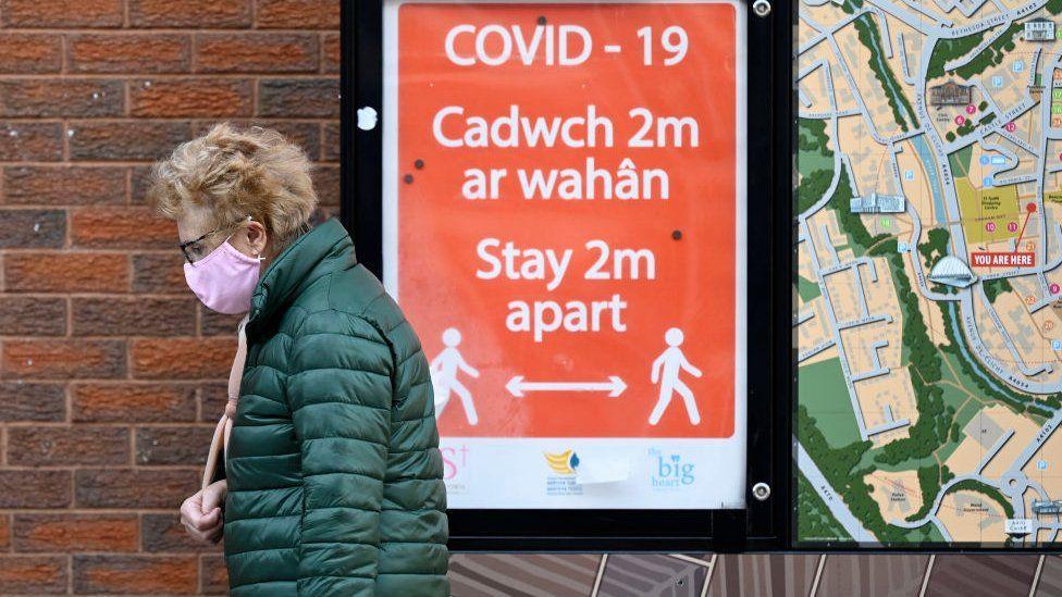 Woman shopping in Merthyr