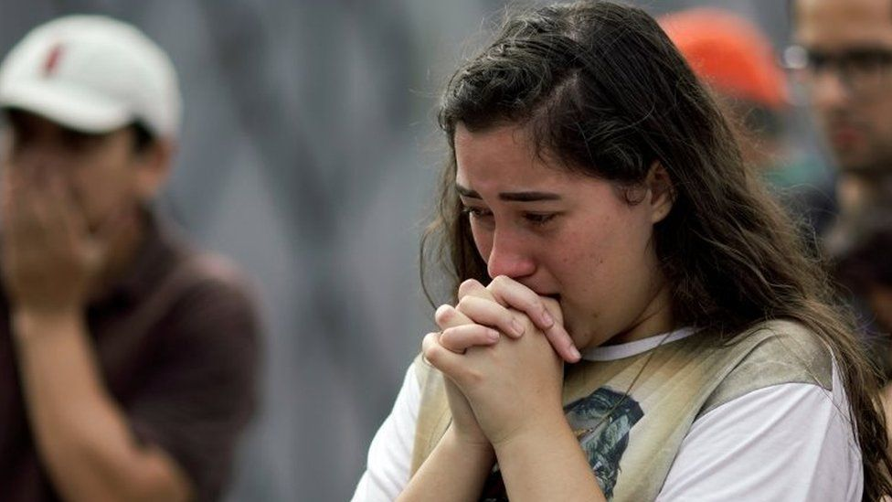 A student reacts as she pays homage to victims killed in a shooting at Raul Brasil School, in Suzano, Brazil March 14, 2019.