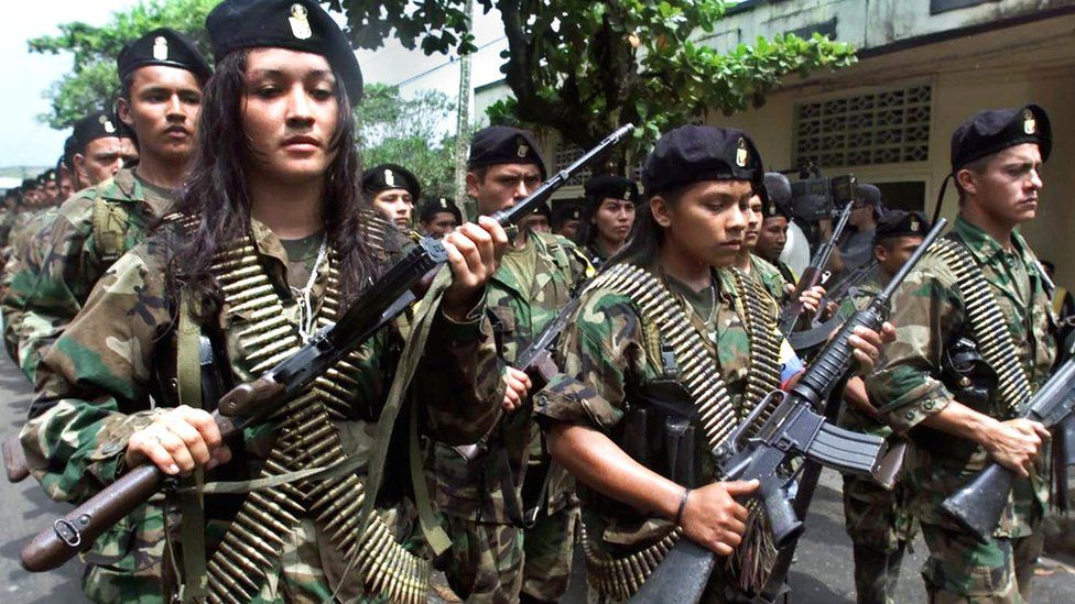 Far rebels parade in the Colombian town of San Vicente in 2001.