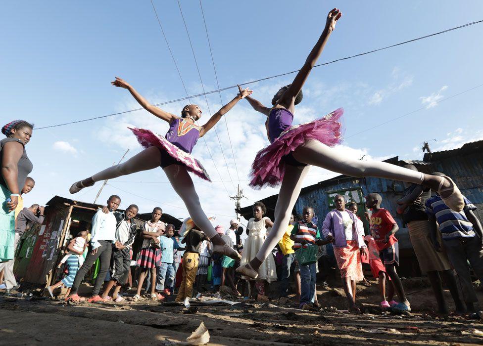 Young ballerinas from different schools perform a dance during a ballet street performance to showcase their skills in Kibera slum, Nairobi, Kenya - Friday 30 November 2018