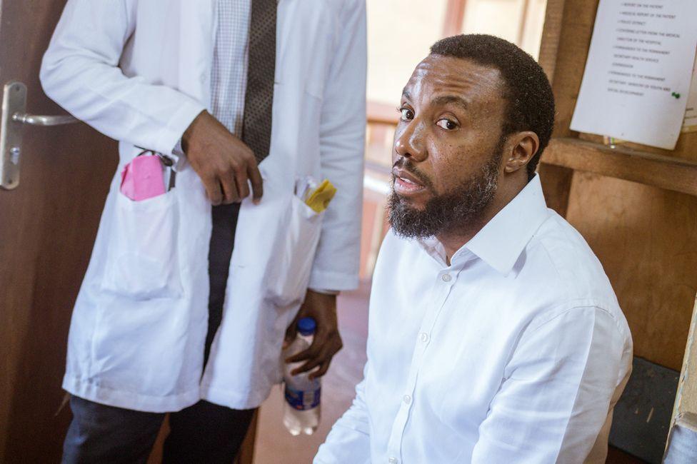 Zeal Akaraiwai and doctor in white coat