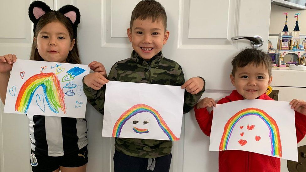 Aaron, Amelia and Alex with rainbows
