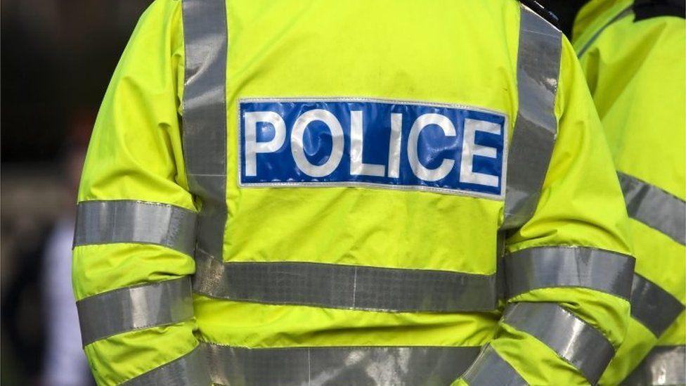 A police officer wearing a hi-vis jacket