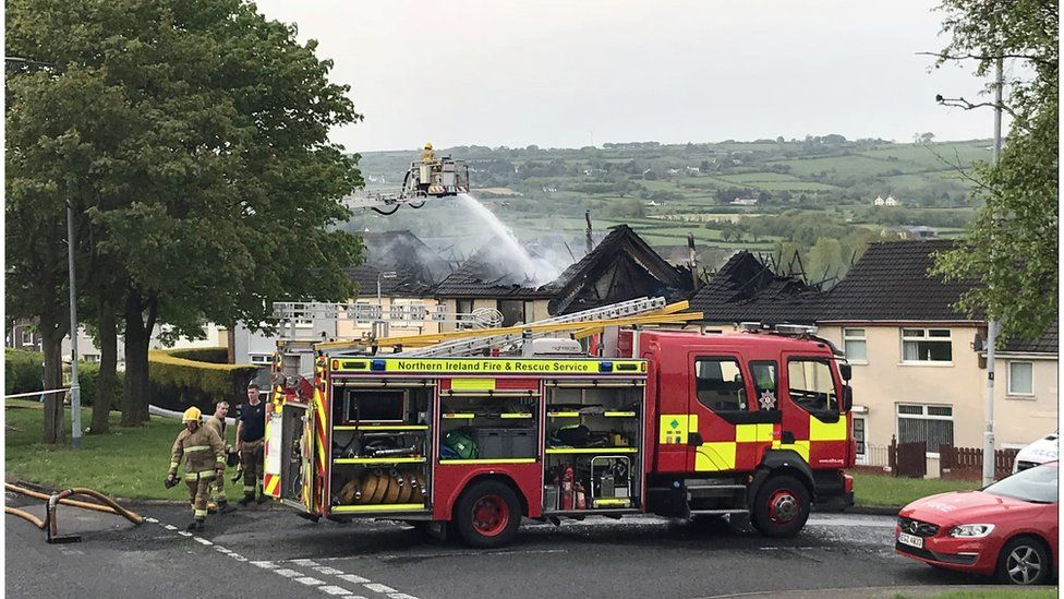 Fire service putting out fire at homes in County Antrim