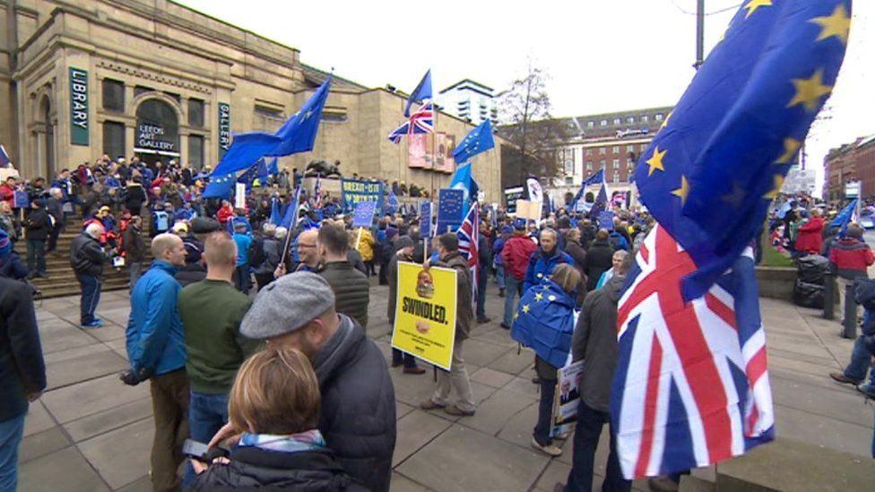 People rallying in front of Leeds Art Gallery