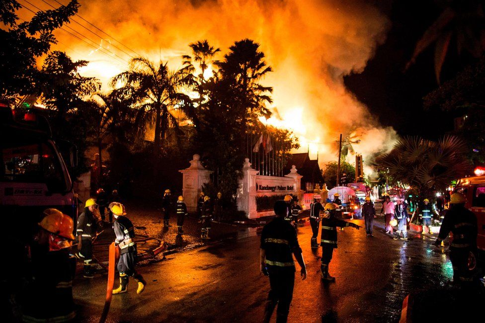 Firefighters work at the scene of a fire at Kandawgyi Palace hotel in Yangon early on 19 October 2017
