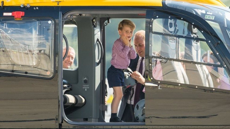 Prince George on a helicopter