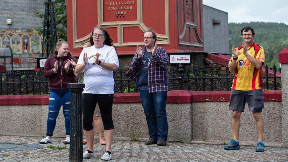 People clap in Tredegar, Wales