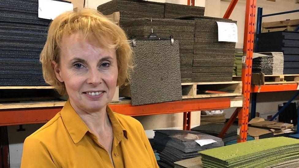 Managing director Ellen Petts in front of carpet tiles