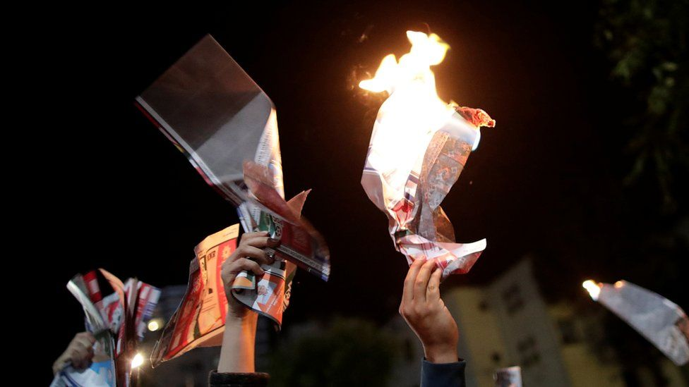 People burn ballot papers during a protest in Bolivia