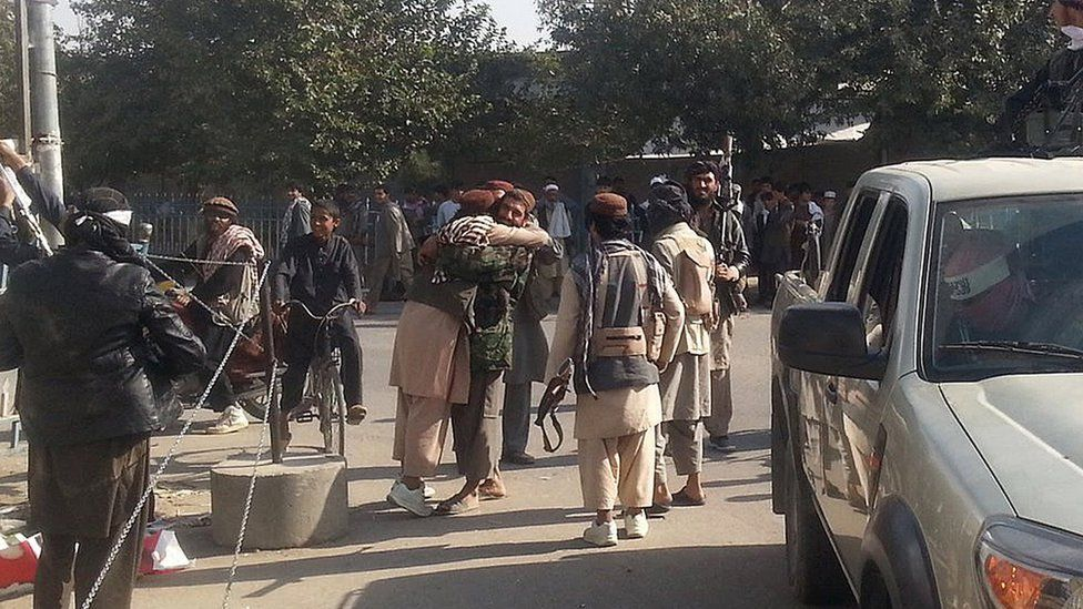 Taliban fighters hug each other in Kunduz