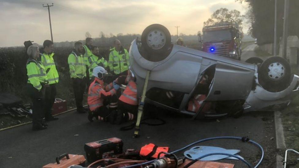 Car upside down after crash in Marholm