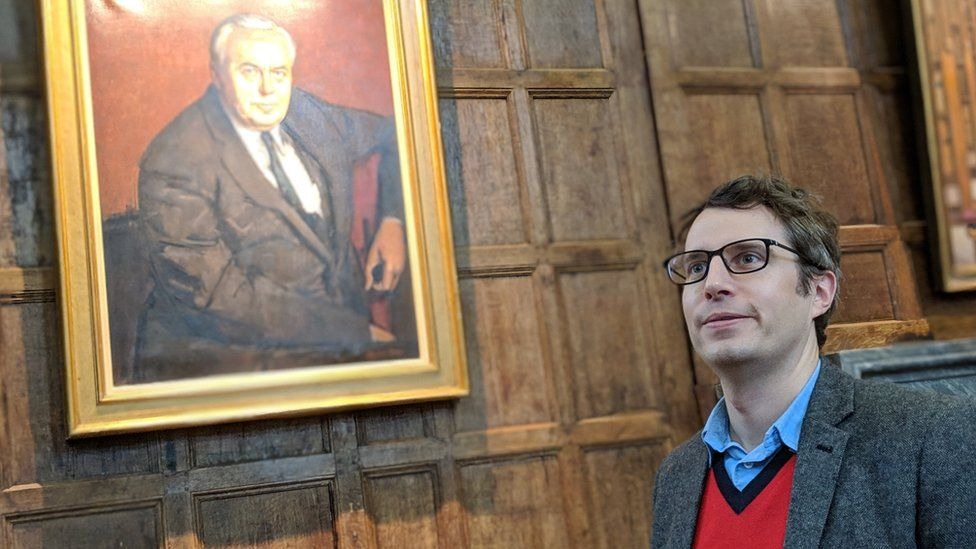 James Tilley and a portrait of Harold Wilson