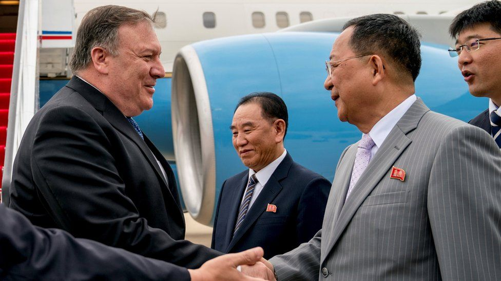 U.S. Secretary of State Mike Pompeo is greeted by North Korean Director of the United Front Department Kim Yong Chol, and North Korean Foreign Minister Ri Yong Ho, as he arrives at Sunan International Airport in Pyongyang, North Korea, July 6, 2018.