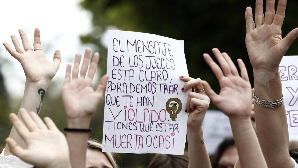 """A hand-made protest sign reads in Spanish: """"The judges' message is clear. To prove you've been raped, you must be dead or nearly dead"""""""