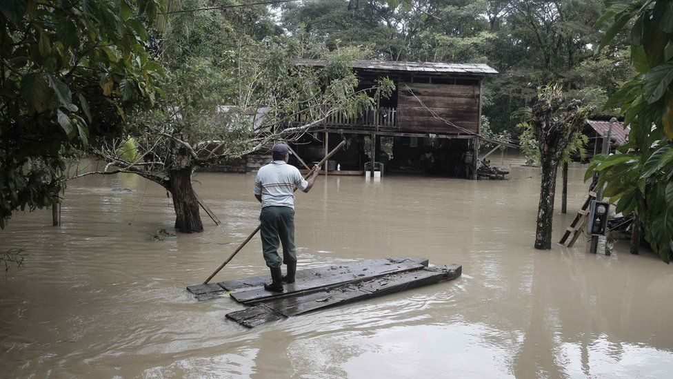 A man in an improvised canoe arrives to his flooded house in Upala, San Carlos, Costa Rica