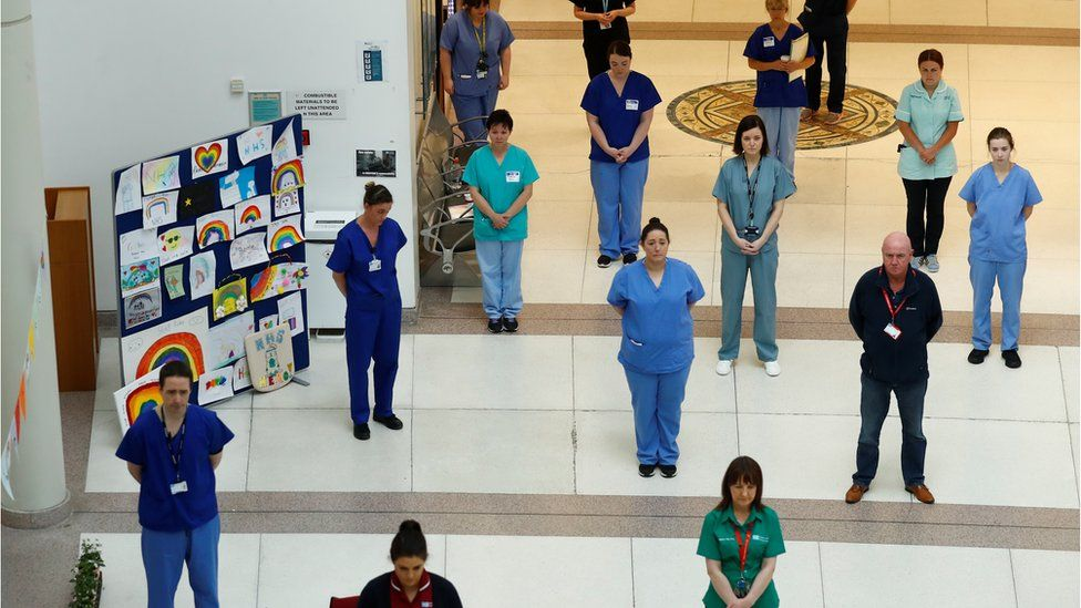 NHS staff observe a minute's silence in honour of key workers who have lost their lives due to COVID-19 at Mater Infirmorum Hospital, following the outbreak of the coronavirus disease (COVID-19), Belfast, Northern Ireland