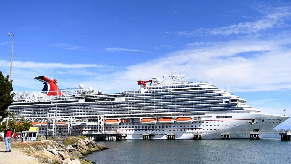 Travellers trying to board the Carnival Panorama cruise ship for a 7 day trip were met with a delay in Long Beach, US.