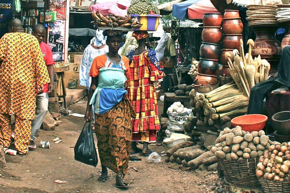 A woman walks through the market