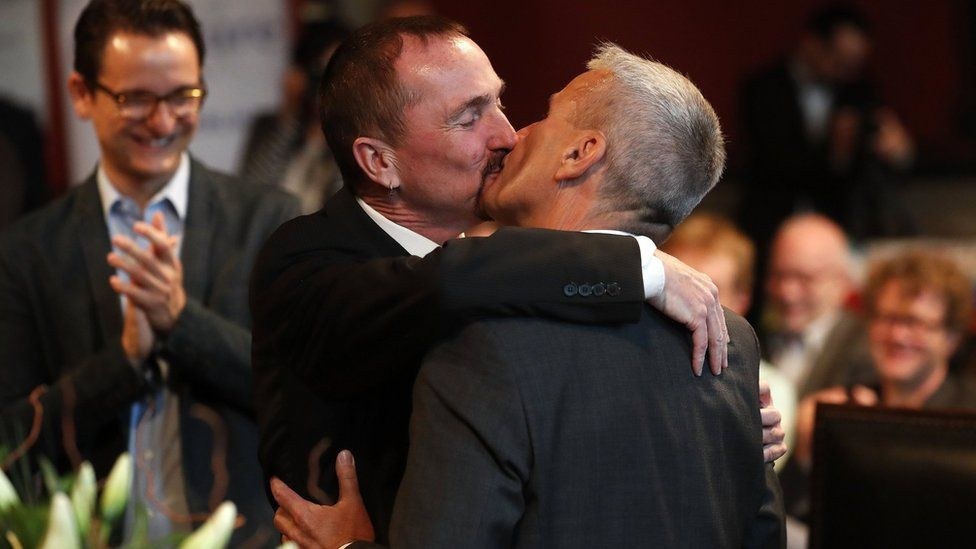 Karl Kreile (L) kisses Bodo Mende during the first civil wedding ceremony between two men in Berlin, Germany (01 October 2017)