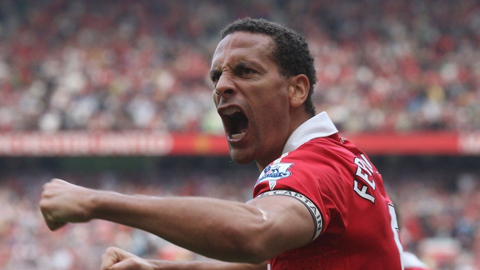 Rio Ferdinand playing for Man Utd