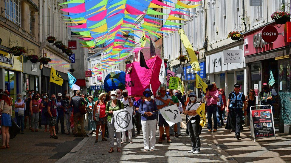 Protestors take part in an XR protest in Falmouth, during the G7 summit in Cornwall. Picture date: Saturday June 12, 2021.