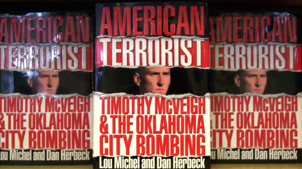 Copies of American Terrorist on book shelf