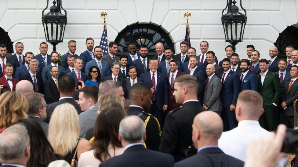 US President Donald Trump (C) poses with the 2018 World Series Champions Boston Red Sox at the White House in Washington, DC, on May 9, 2019