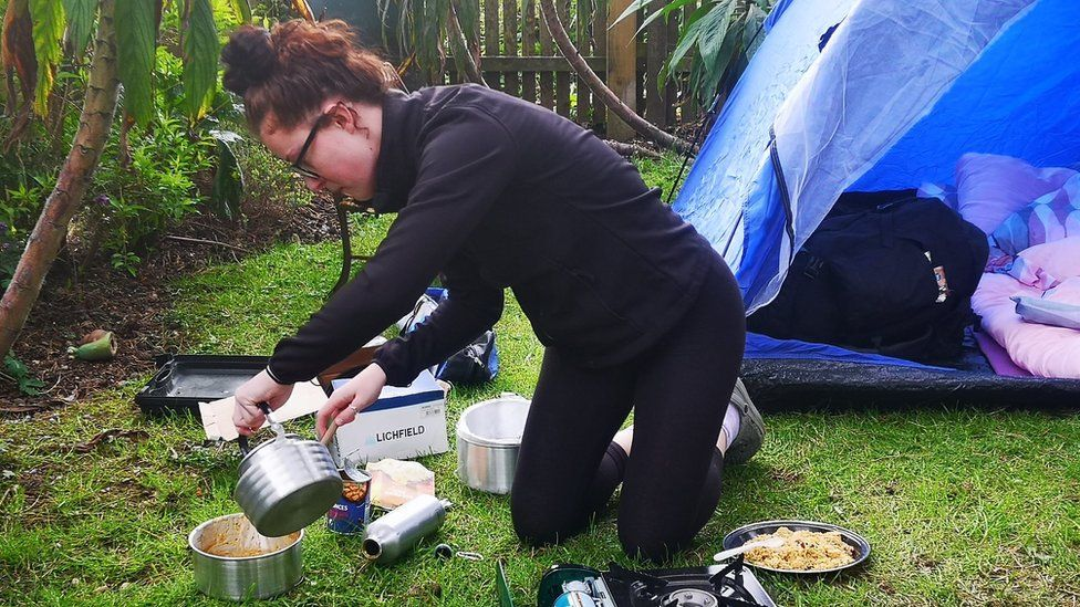 Izzy Fellows-Barnett with camp cooking equipment